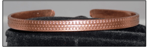 Narrow copper cuff bracelet with pattern